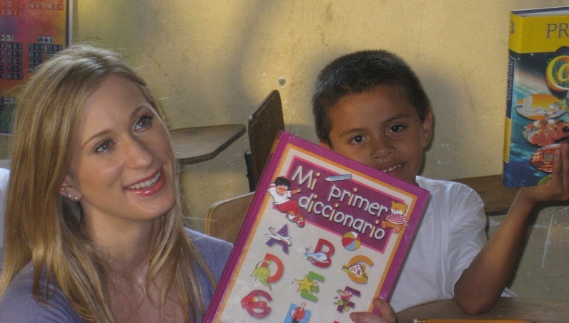Joannie Rochette in Honduras with young World Vision friend